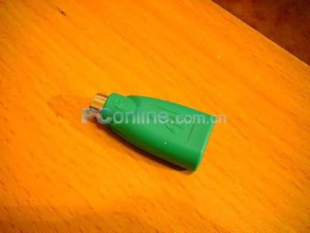 记得我以前买罗技的usb光电鼠标曾经送过一个usb转ps2的转换头,看来