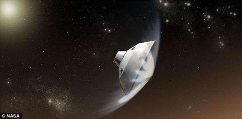 """搭载""""好奇""""号火星车的""""火星科学实验室""""飞船将以每小时1.32万英里(2.12万公里)的速度撞上这颗红色行星的大气最顶层"""
